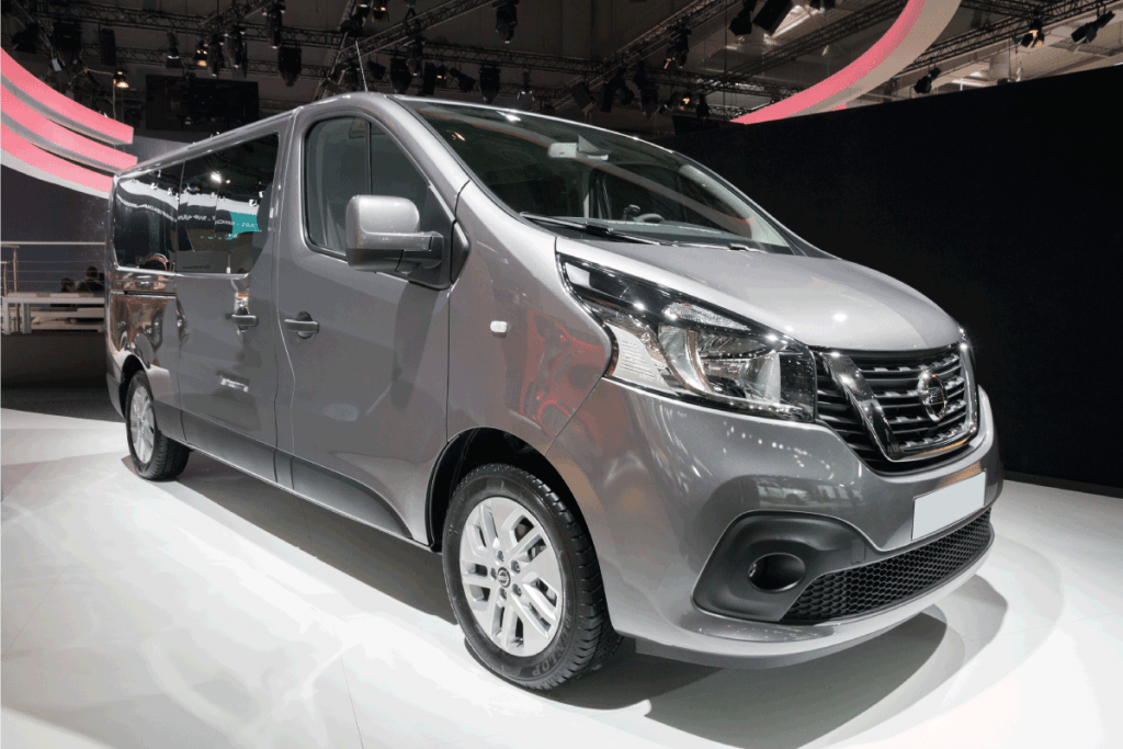 gray nissan nv van presented in an international motor show. How Much Does A Nissan NV Weigh [Inc. 2500 And 3500]