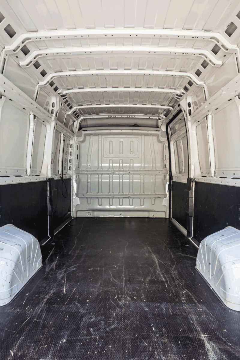 interior of the empty load compartment of a white van