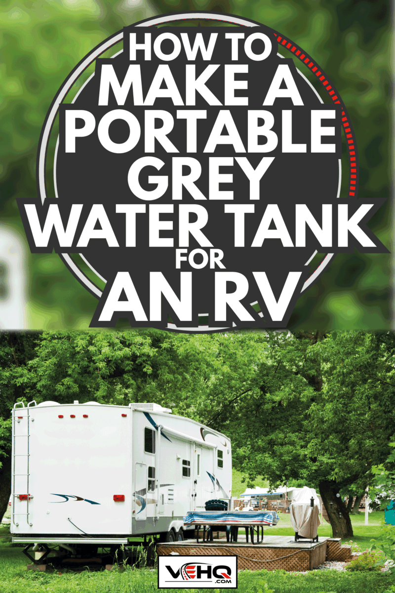 recreational vehicle parked at a camping ground with kitchen setup just outside. How To Make A Portable Grey Water Tank For An RV
