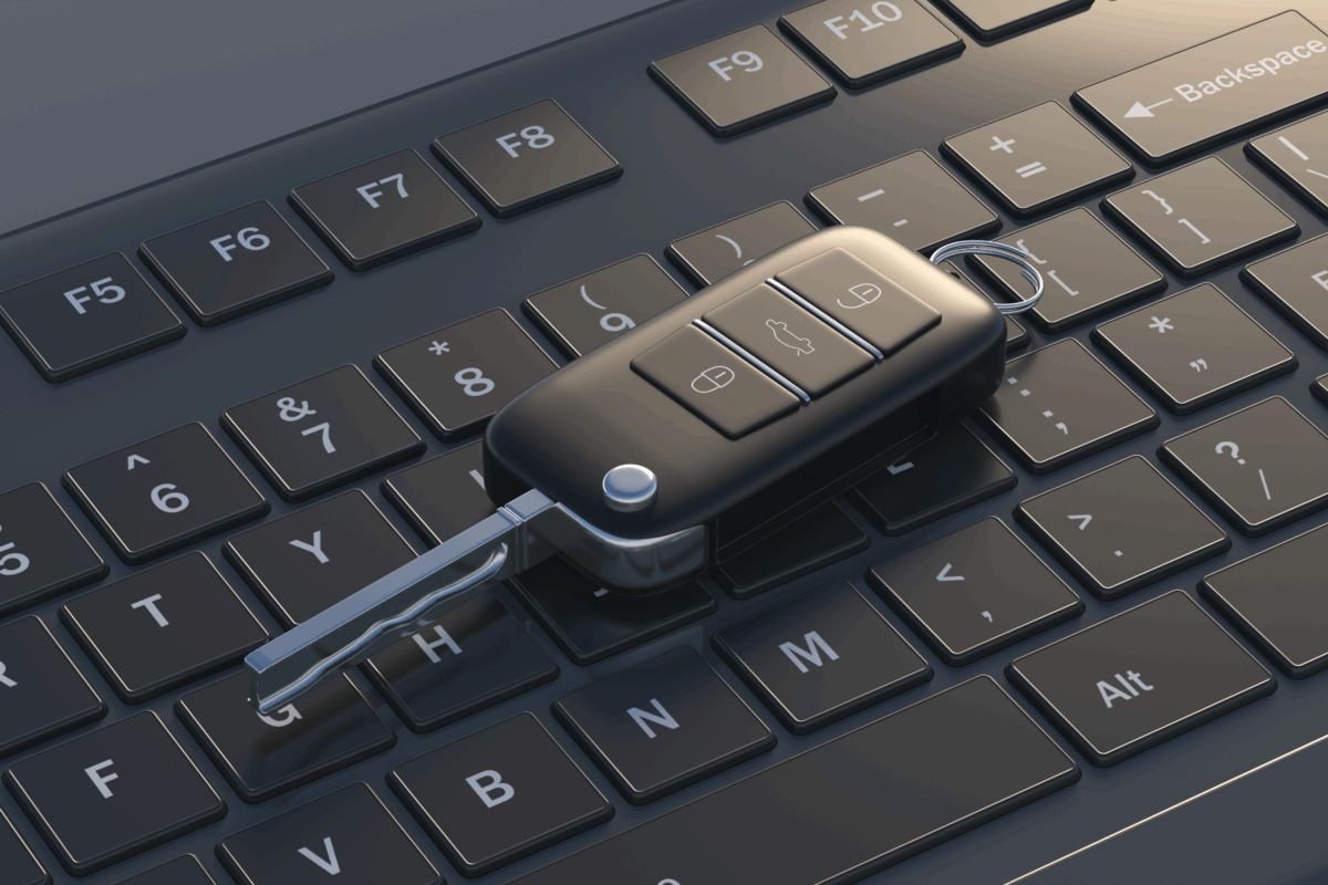 remote control flip key on top of a laptop keyboard