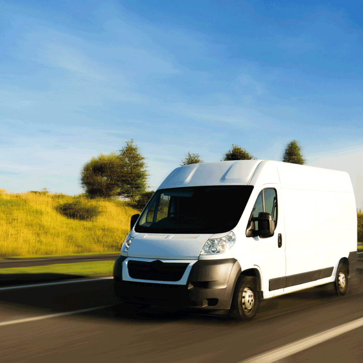 white delivery van running fast on highway