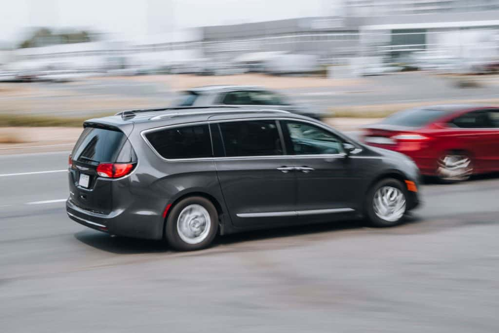 A Chrysler Pacifica moving on the highway, How Many Batteries Does A Chrysler Pacifica Have? [And How Do You Change Them?]