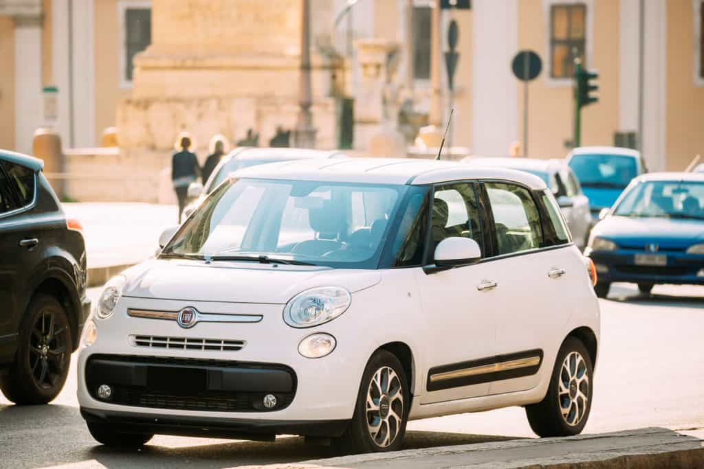 A Fiat 500L parked on the street