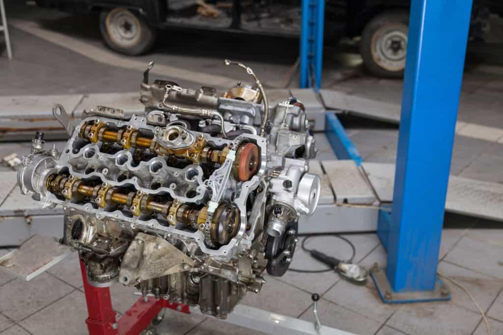 A V8 engine mounted on a crane
