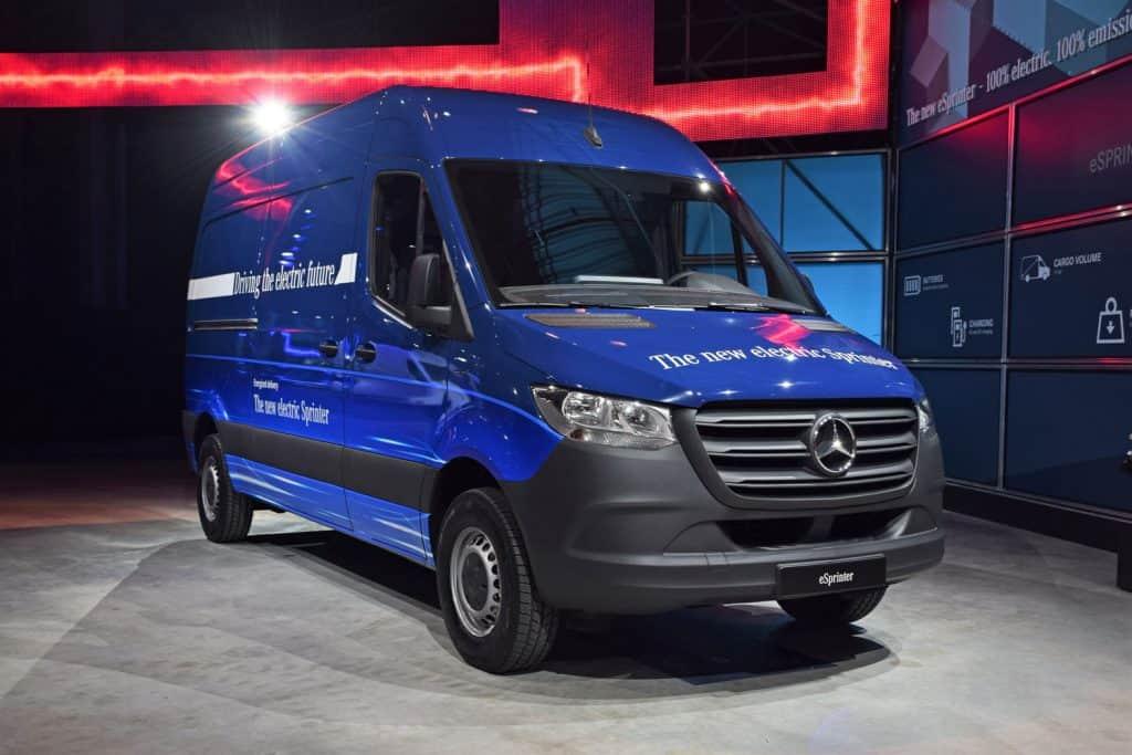A blue Mercedes Sprinter van at a car show