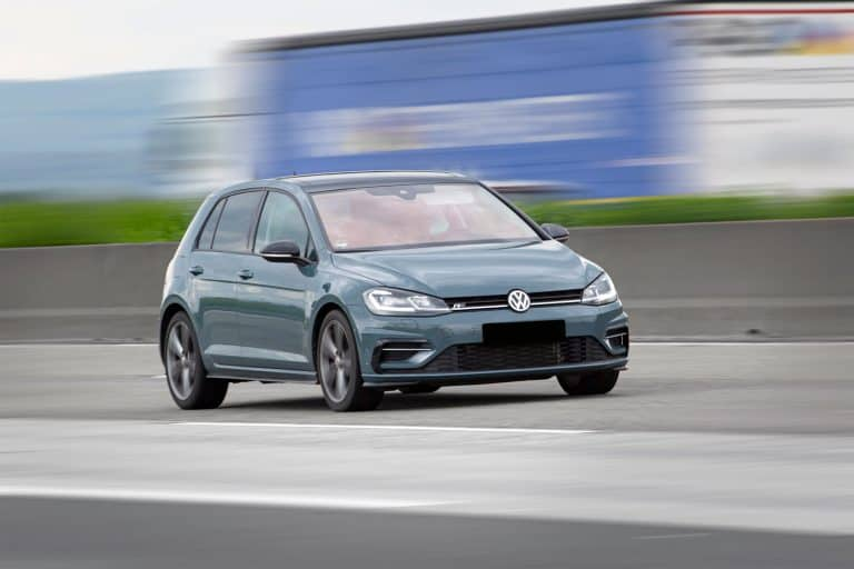 A gray Volkswagen Golf moving fast on the freeway, How Long Does A Volkswagen Golf Last?