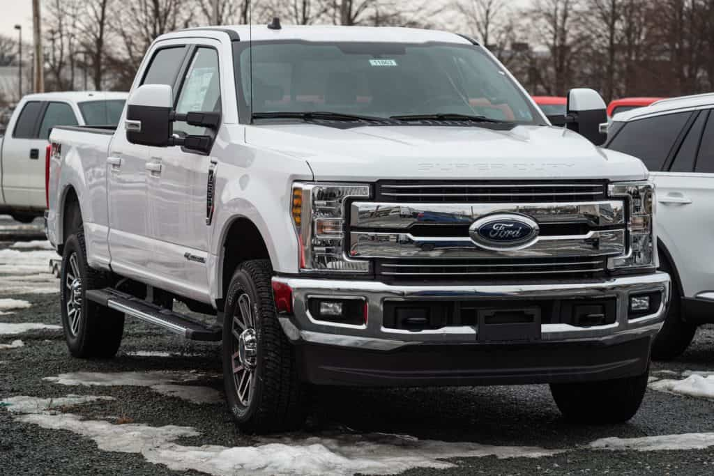 A huge white Ford F 150 on the snowy parking lot