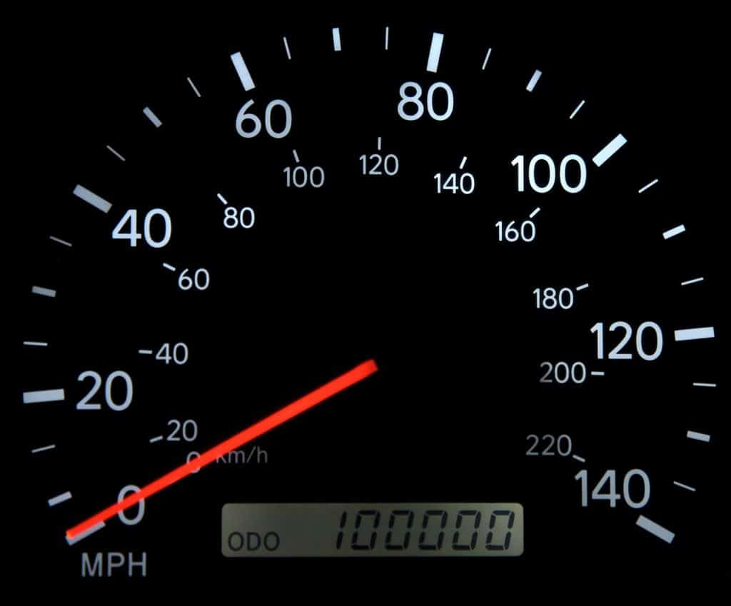 A speedometer with 100,000 miles on it