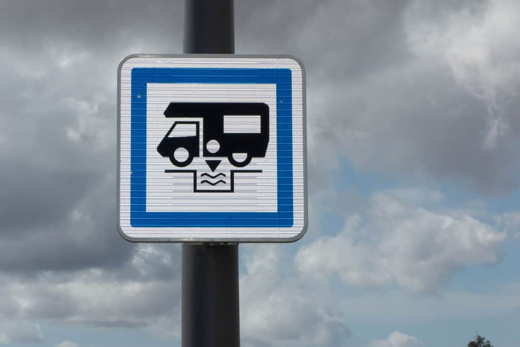 Camper sign in US, blue sign on a pole for dumping station, Do Truck Stops Have RV Dump Stations?