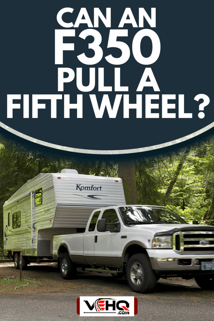 A Komfort brand Fifth Wheel Travel Trailer and Ford F350 Pickup are shown pulling out of the camping space, Can An F350 Pull A Fifth Wheel?