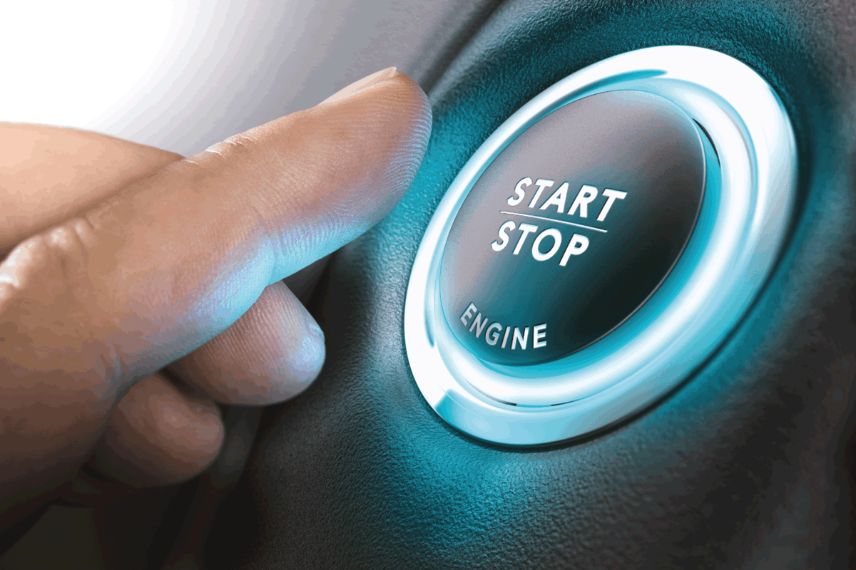 Car stop start system with finger pressing the button