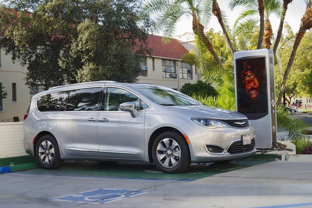 Chrysler Pacifica shown at a free charging station in the City