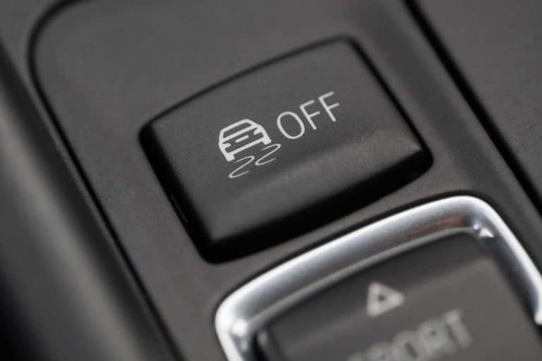 Close up shot of the ESP button in a car, Should Traction Control Always Be On?