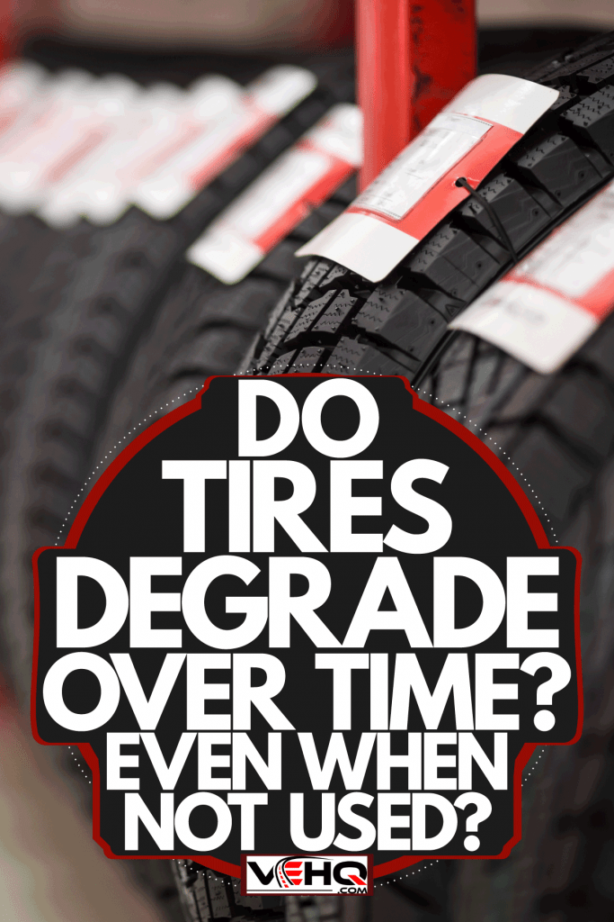 Fresh new tires with labels inside the tire dealer store, Do Tires Degrade Over Time? Even When Not Used?