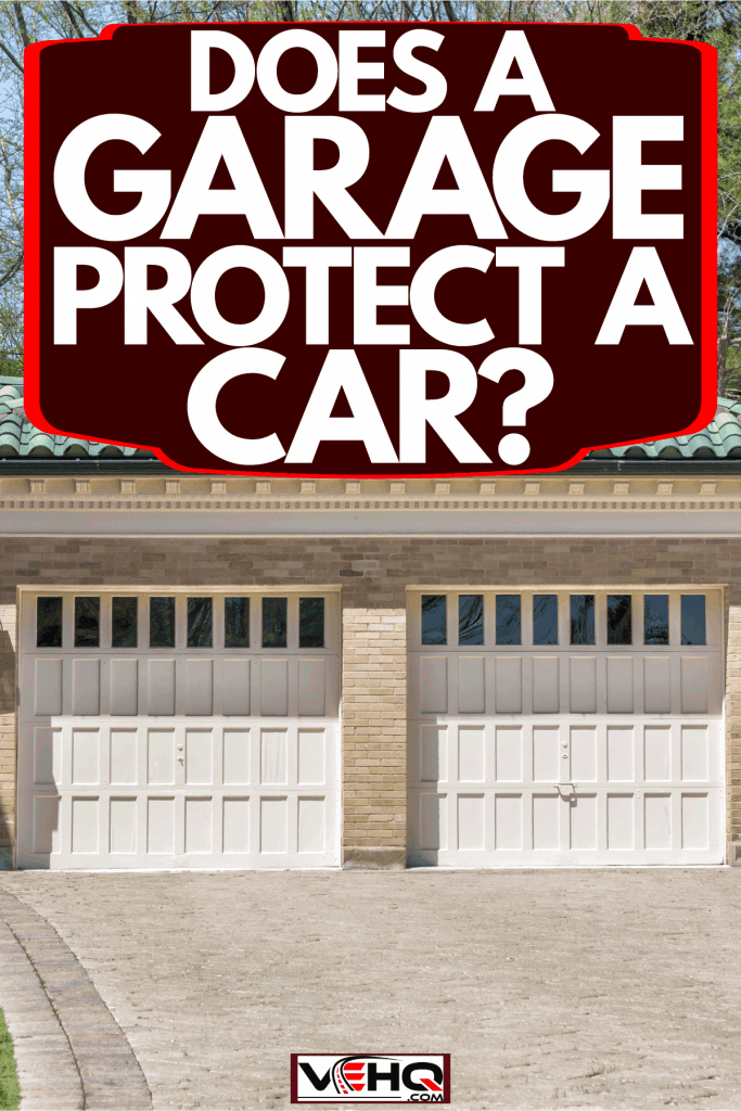 A two door garage painted in white, Does A Garage Protect A Car?