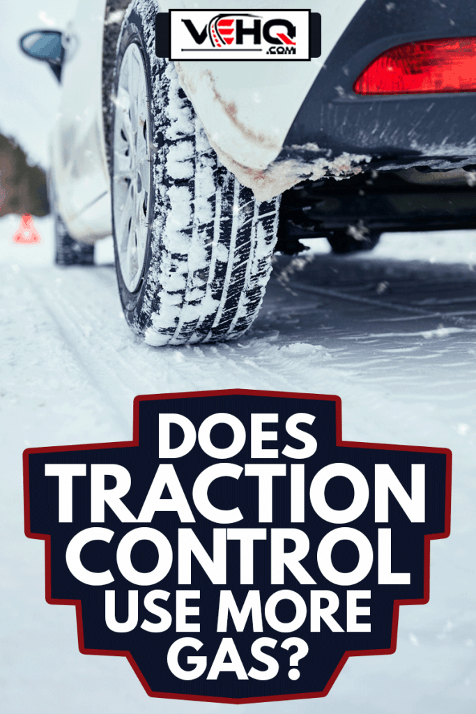 Close up shot of winter car tire on snowy road using traction control, Does Traction Control Use More Gas?