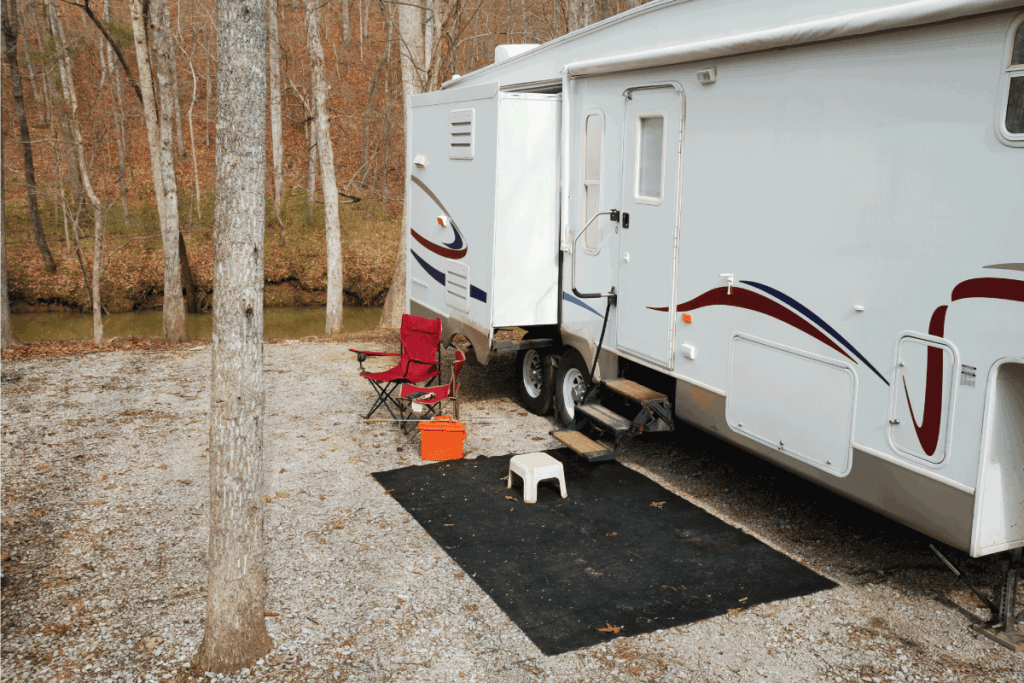 Fifth-wheel-travel-trailer-at-gravel-creekside-campsite.-RV-Electric-Steps-Not-Working---What-to-Do