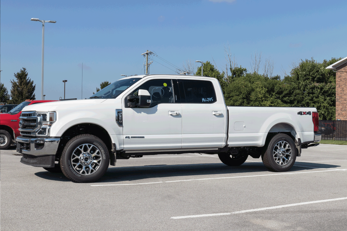Ford F-350 display at a dealership. The Ford F350 is available in XL, XLT, Lariat, King Ranch, and Platinum models. Can You Convert An F250 To An F350 [Pros, Cons, And How To]