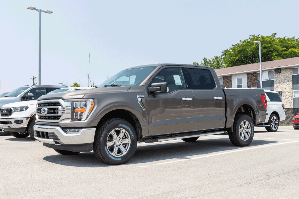 Ford F150 display at a dealership. The Ford F-150 is available in XL, XLT, Lariat, King Ranch, Platinum, and Limited models. What Pickup Trucks Are Hybrid