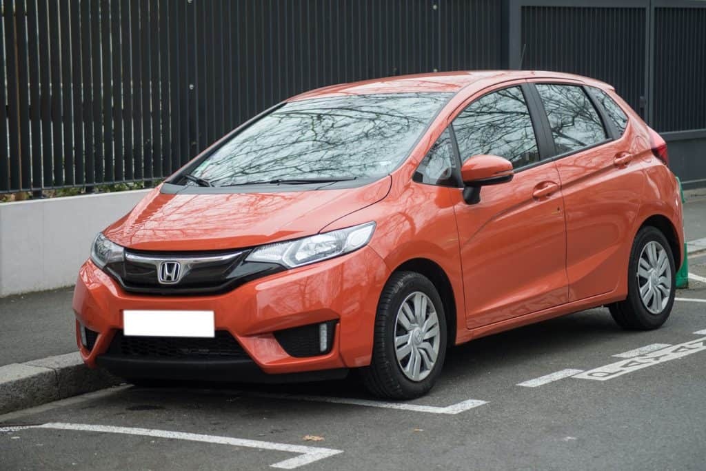 Front view of orange Honda Fit parked in the street, Does Honda Fit Have AWD?