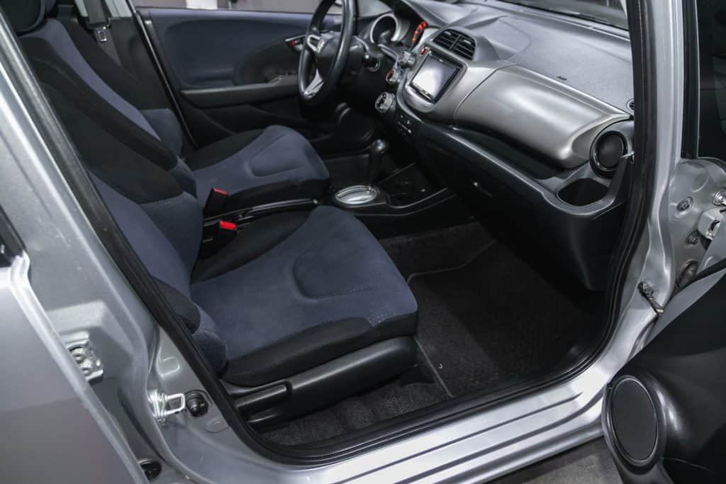 Honda Fit, car Interior - steering wheel, shift lever and dashboard, climate control, speedometer, display