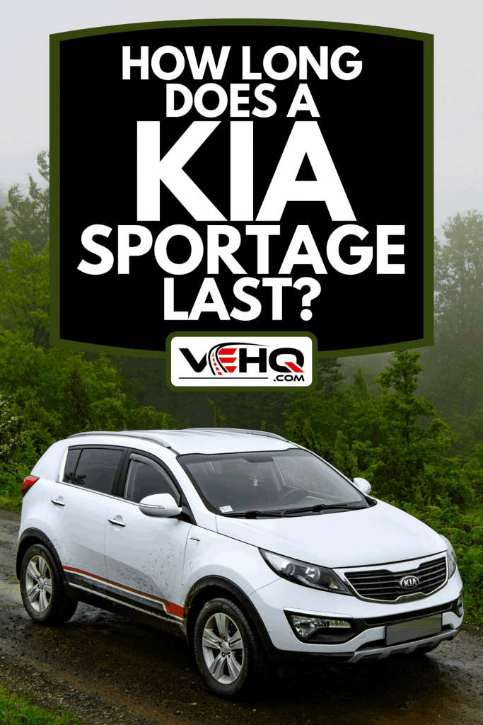 A SUV car Kia Sportage 2.0 early morning on the dirth mountain road, How Long Does A Kia Sportage Last?