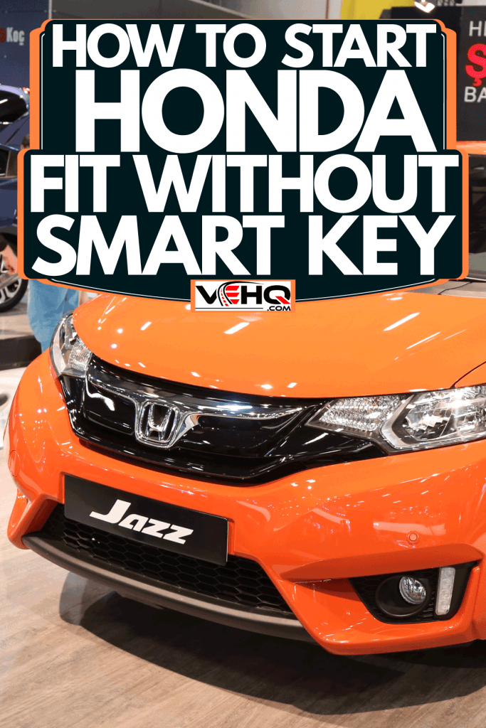 An orange colored Honda Fit displayed at the car show, How To Start Honda Fit Without Smart Key