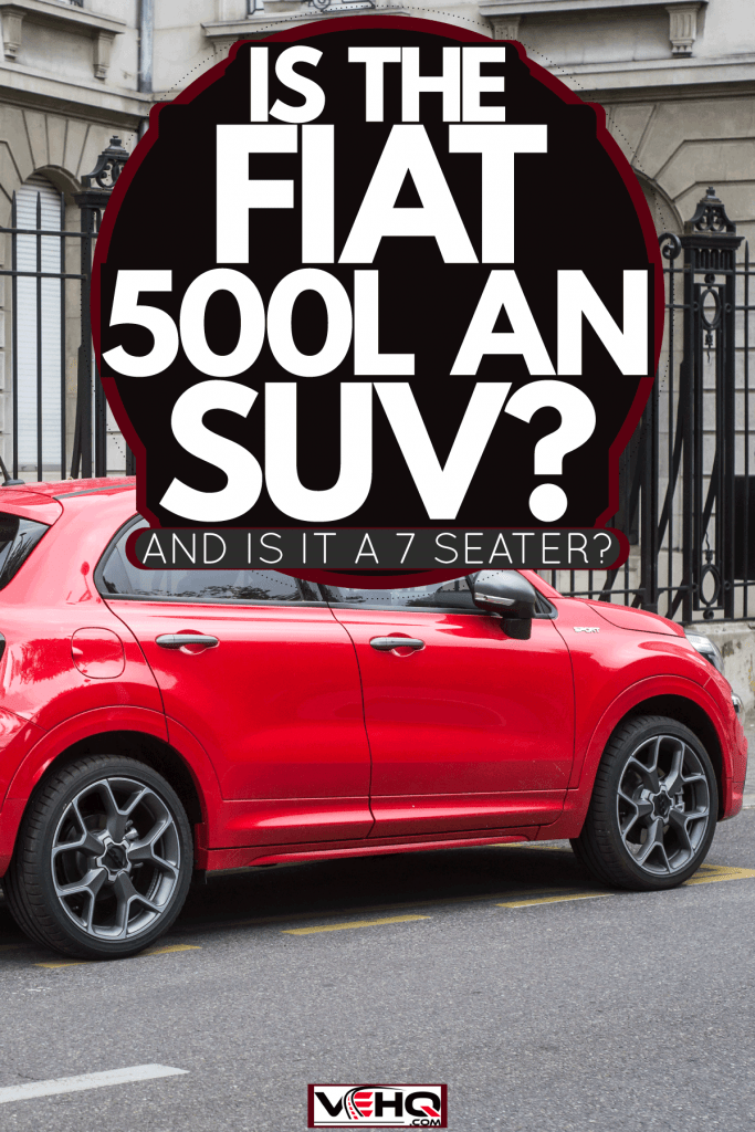 A red Fiat 500X parked next to a palace, Is The Fiat 500L An SUV? [And Is It A 7 Seater?]