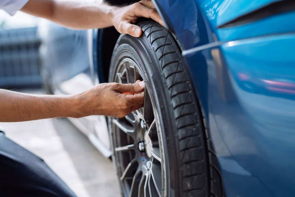 Maintenance male checking and removing tire valve filling nitrogen service on street at gas station, Safety vehicle to reduce accidents before a long travel, Blue car of man transportation lifestyle, Can You Put Air In A Tire With Nitrogen?