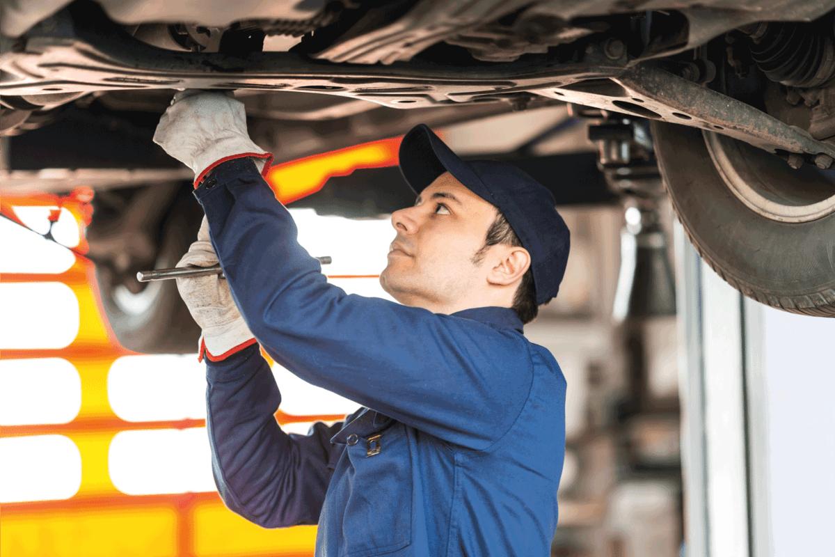 Mechanic repairing car in garage