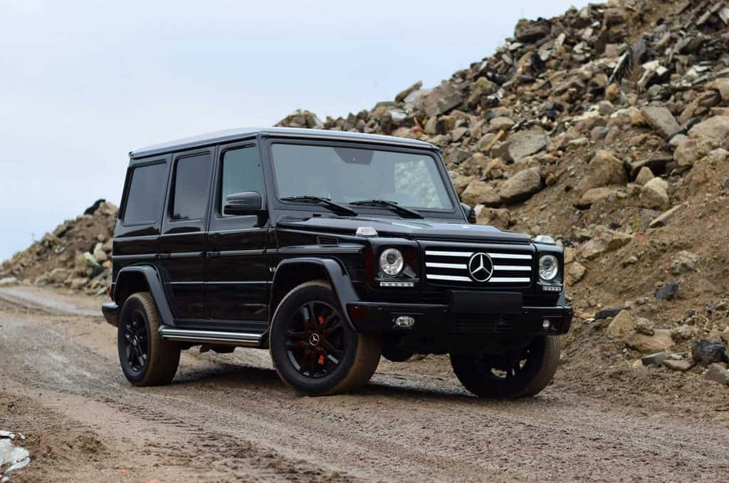 Mercedes-Benz G500 stopped on the unmade road