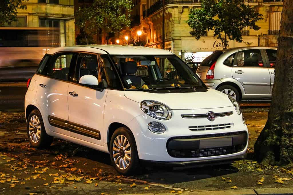 Motor car Fiat 500L is parked in the city street
