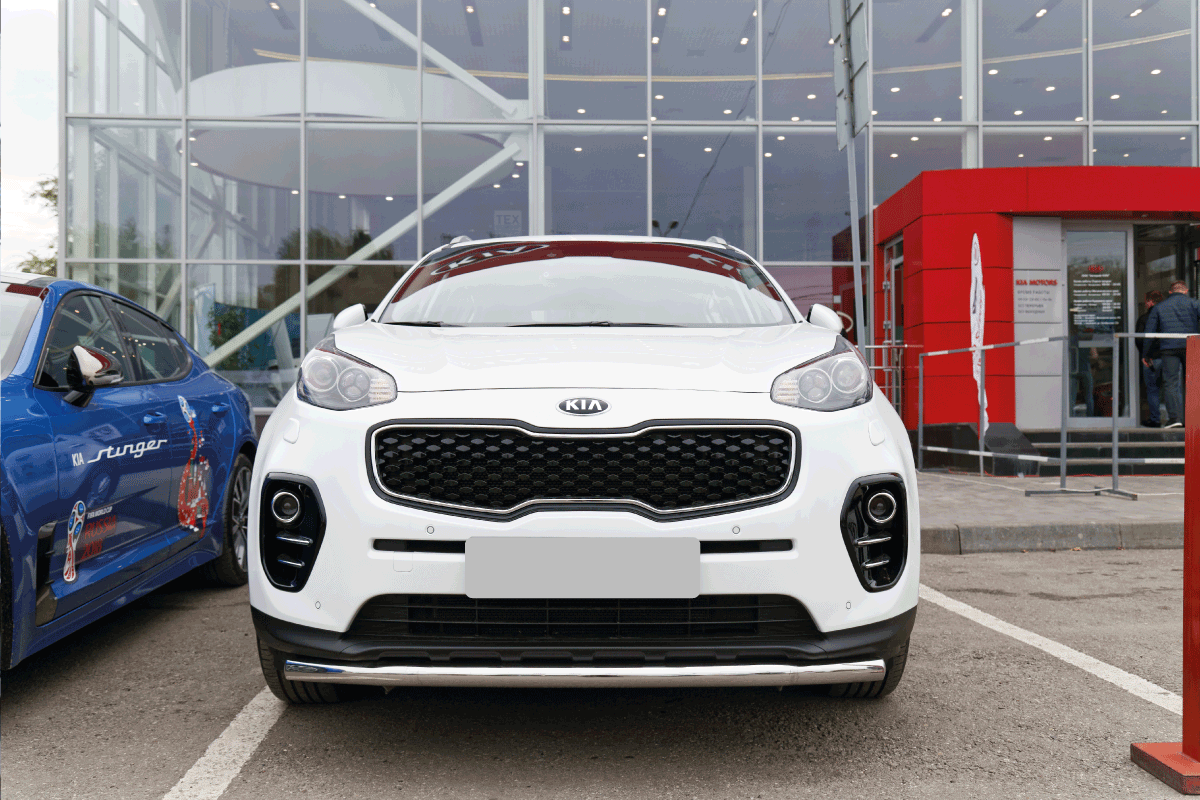 New KIA Sportage - exhibition car stands in front of the building of KIA MOTORS car selling and service center. Can A Kia Sportage Tow A Camper [Inc. 6 Practical Examples]