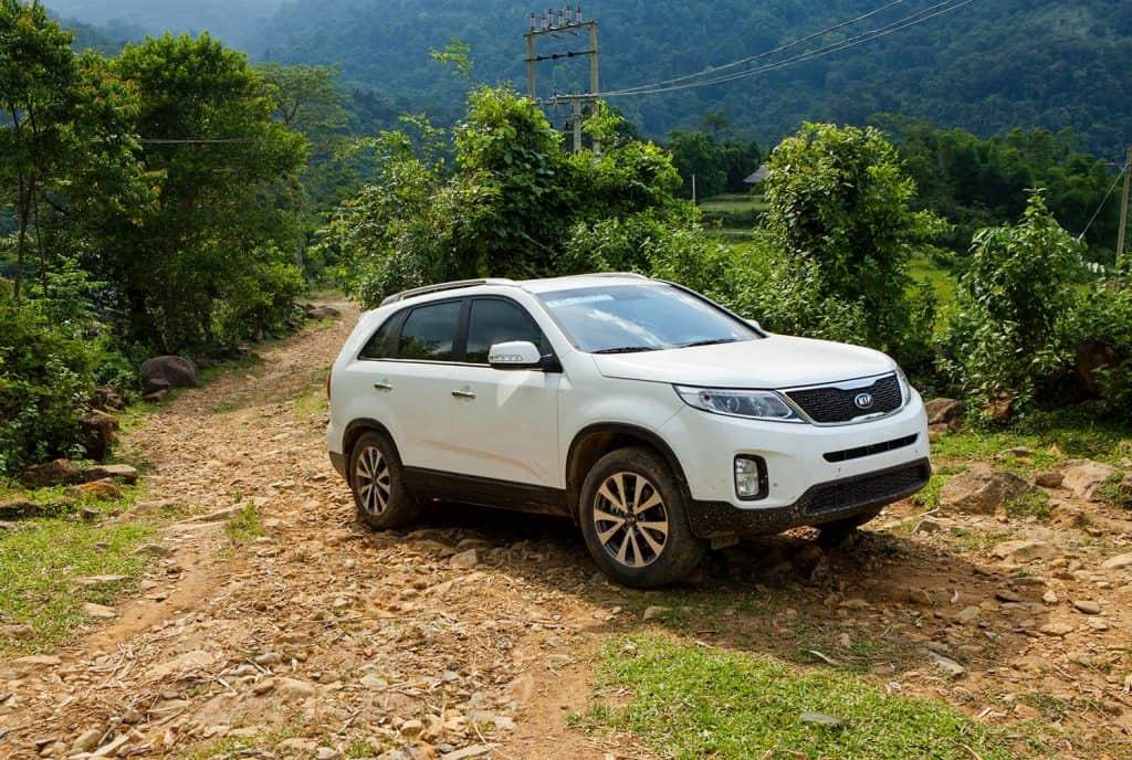 New Kia Sorento car is running on the mountain road