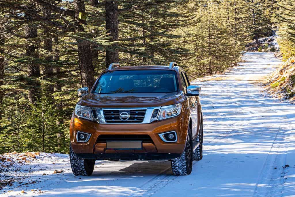 Nissan NP300 Navara on mountain road in a snowy winter day