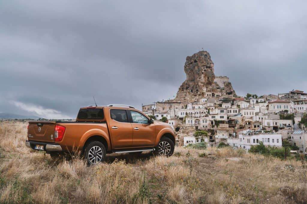 Nissan NP300 Navara stopped on the hill near Ortahisar Castle in Cappadocia, Can A Nissan Frontier Tow A Boat? [Everything You Need To Know]