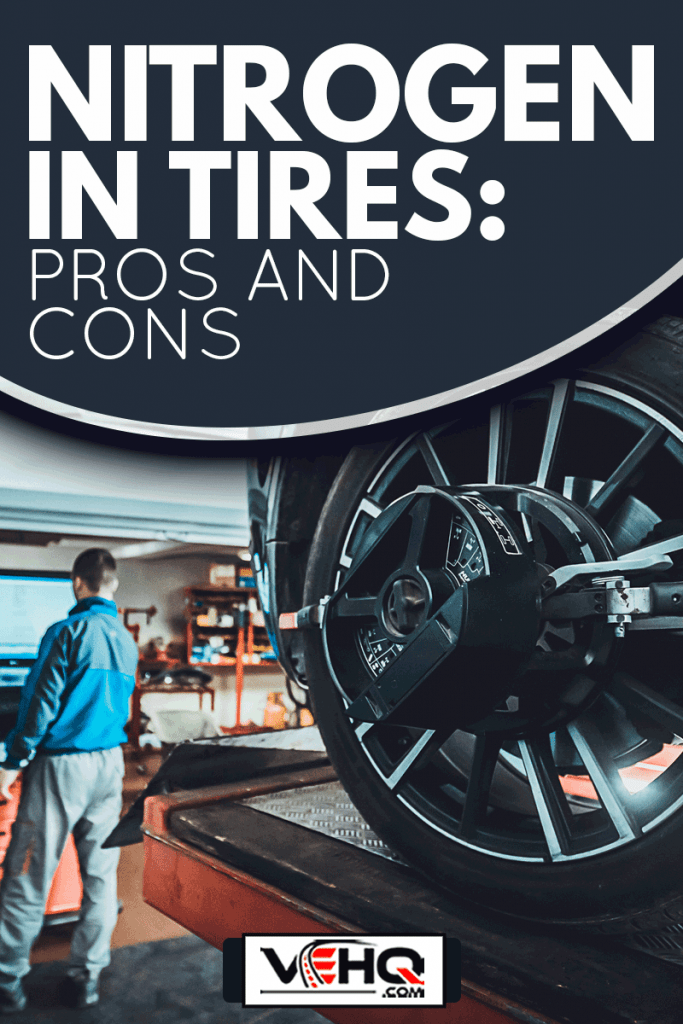 One man, mechanic in auto repair shop with wheel focus, Nitrogen In Tires: Pros And Cons