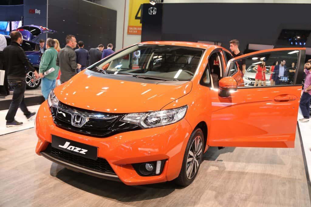 Orange Honda Fit in an International Motor Show