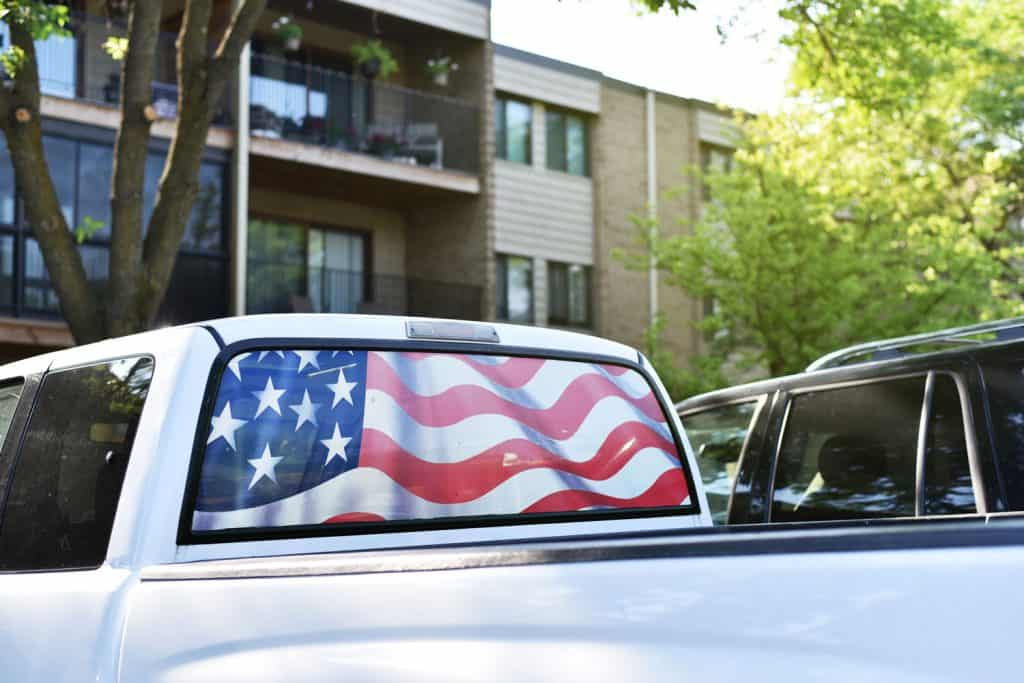 Parked pick up truck vehicle with rear window replaced with the United States flag, What Pickup Trucks Are Made In The USA?