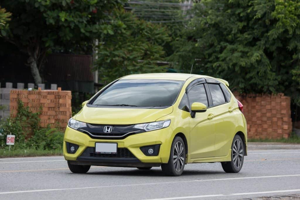 Private city Car Honda Jazz. Five door hatchback automobile
