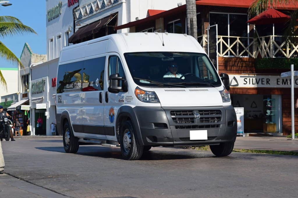Ram 2500 Promaster in minibus version driving on the street