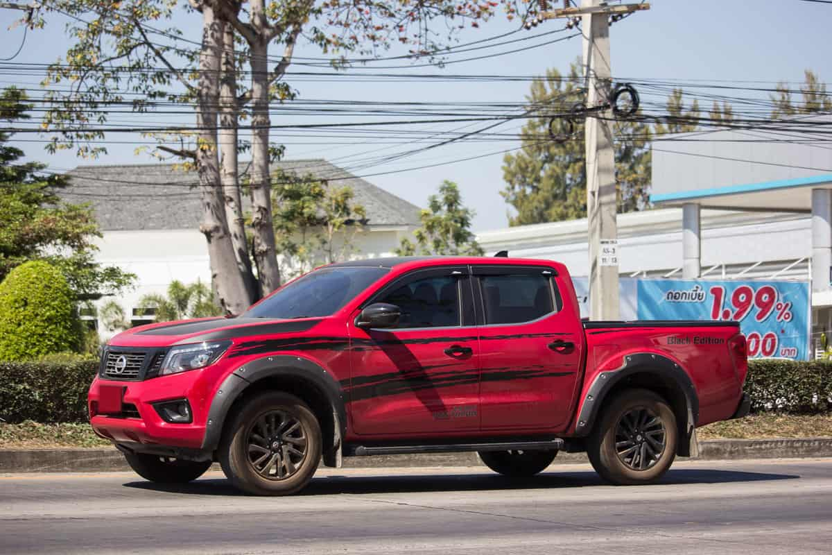 Red nissan frontier on the road, Does Nissan Frontier Have CVT Transmission?