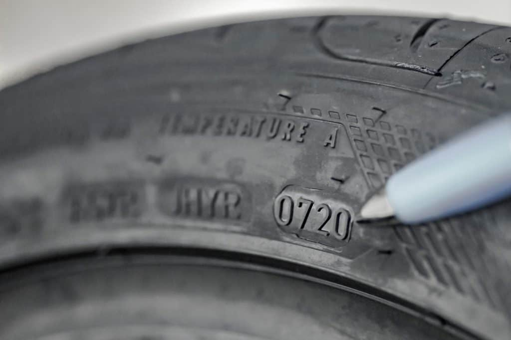 Showing DOT (date of manufacturing) number on a new tire
