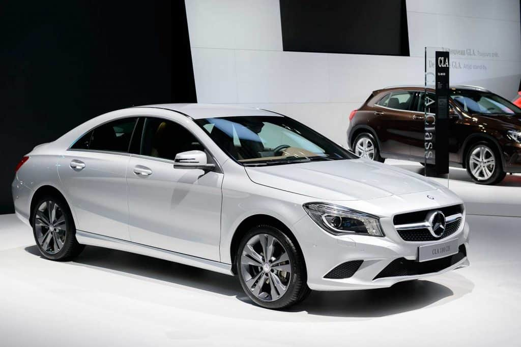 Silver Mercedes Benz CLA compact saloon car on display at motor show