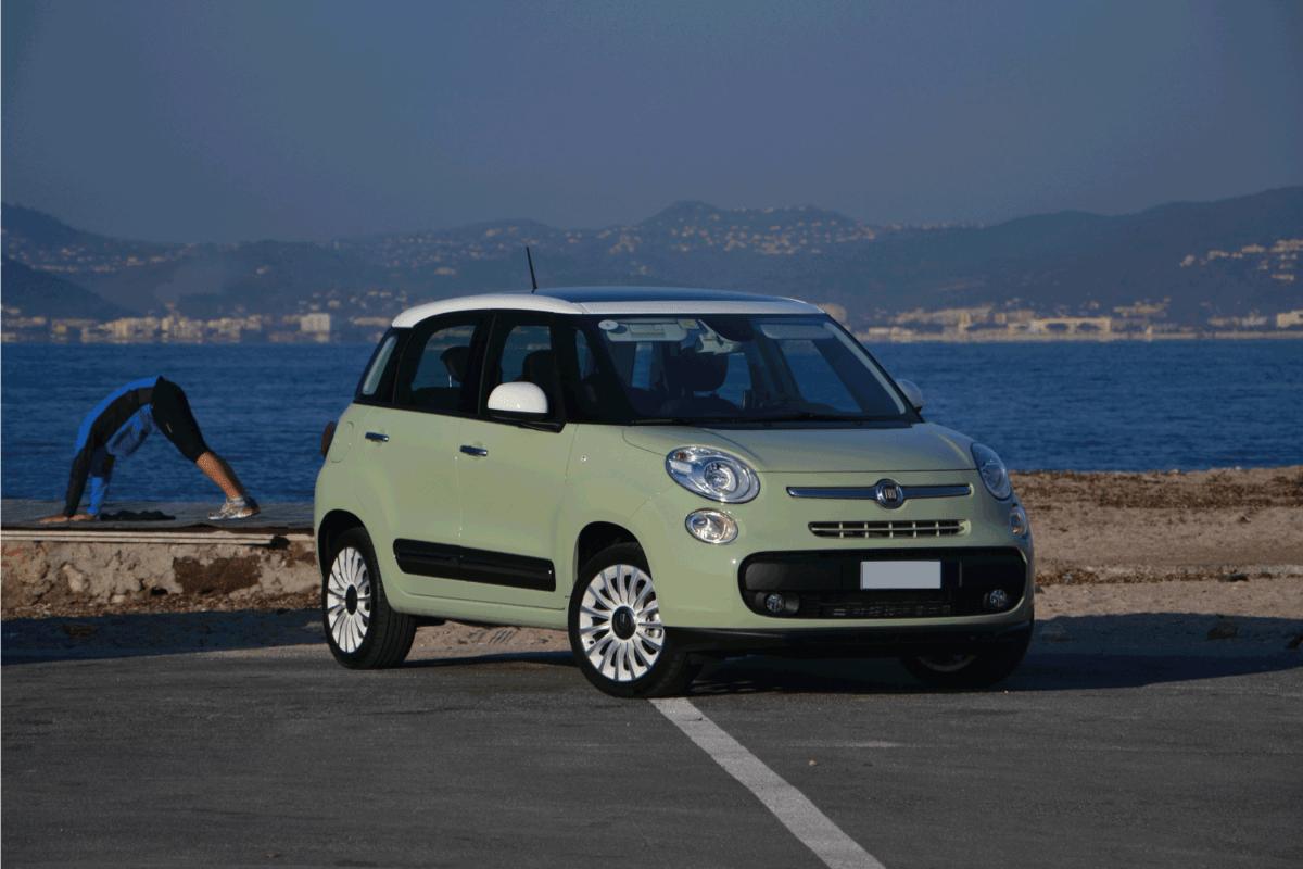 The new minivan Fiat 500L stopped on the parking during the test drive