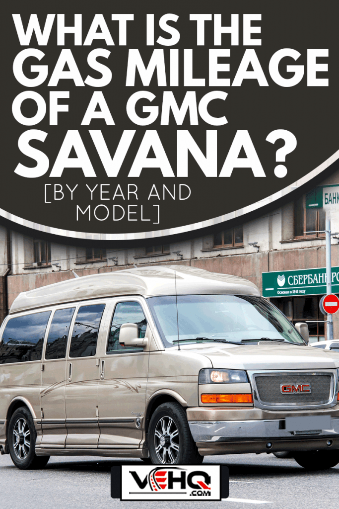 Motor car GMC Savana at the city street., What Is The Gas Mileage Of A GMC Savana? [By Year And Model]