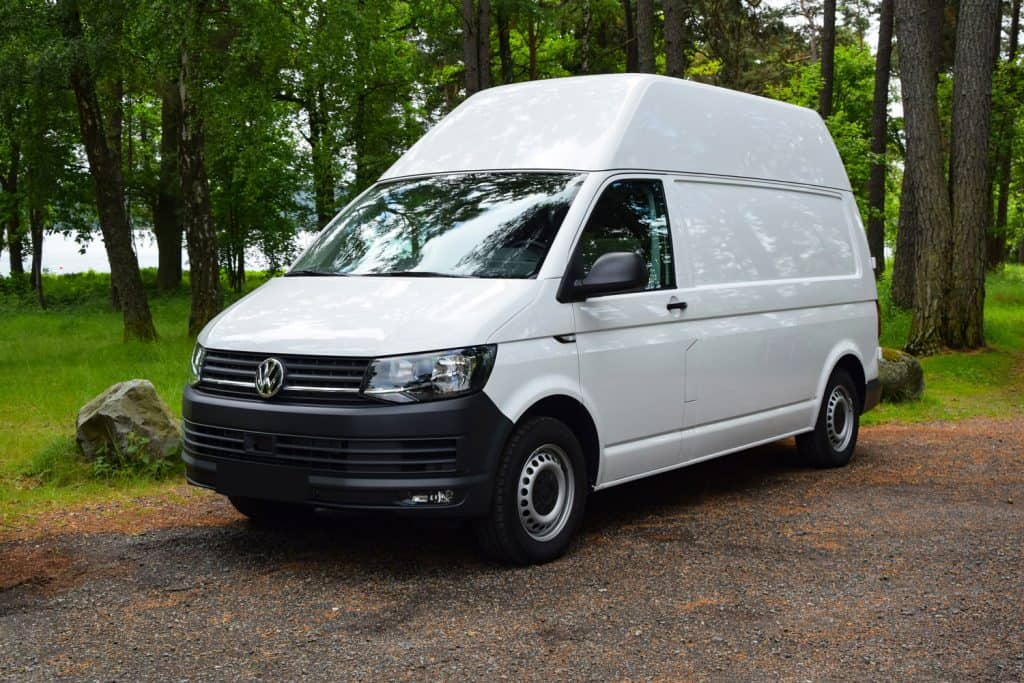 White delivery van Volkswagen Transporter stopped on a parking