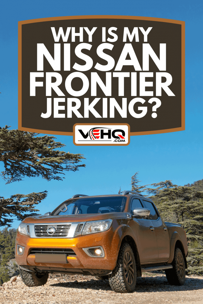 A pickup Truck Nissan NP300 Navara parked at roadside near a big pine tree, Why Is My Nissan Frontier Jerking?