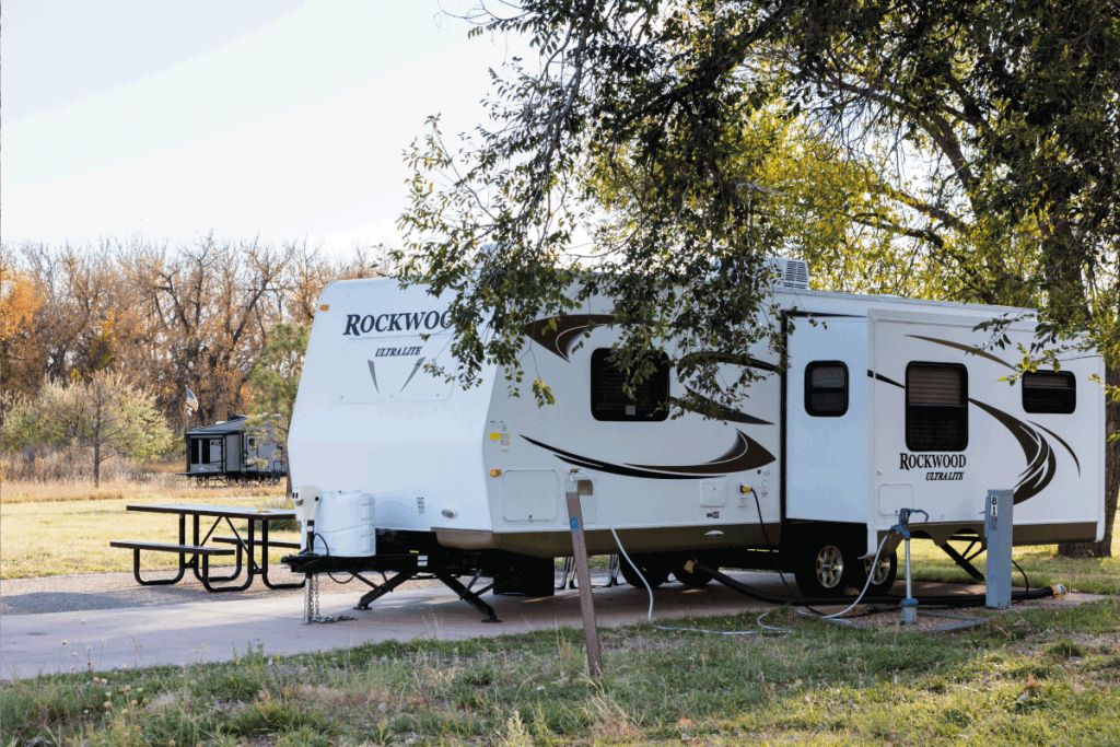 camping in the autumn season in Colorado on a 5th wheel toy hauler. How Much Do Toy Haulers Typically Weigh [Including 11 Examples]