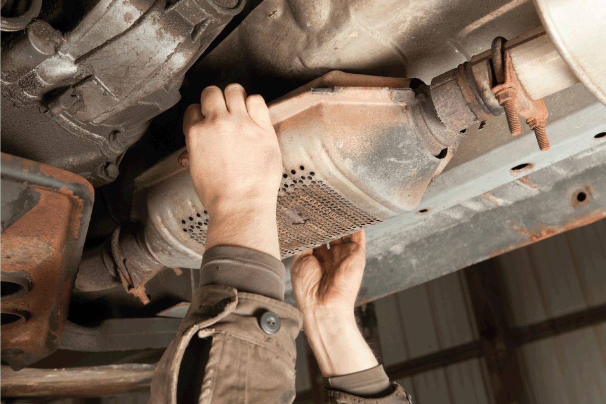 catalytic converter is being removed at a salvage yard
